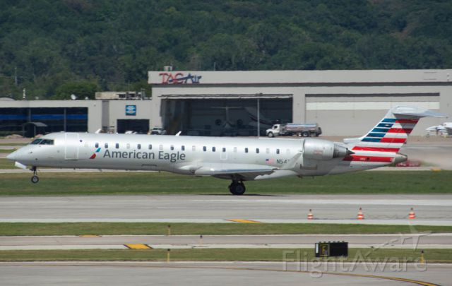 Canadair Regional Jet CRJ-700 (N543EA) - American Eagle (Envoy Air) 4136 is rotating Runway 32L for Chicago O'Hare at 4:03 PM.  Photo taken August 6, 2019 with Nikon D3200 at 300mm.