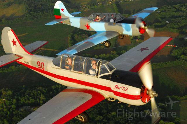 — — - Yak formation flight over Moontown Airport near Huntsville, Alabama. Photo copyright: BlakeMathis.com
