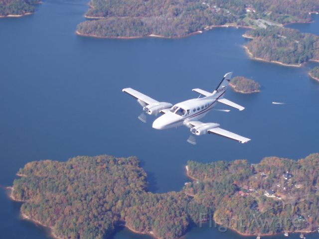 Cessna 421 (N344TC) - Another view of N344TC over Lake Lanier.  Moving into position for Air to Air photo shoot.