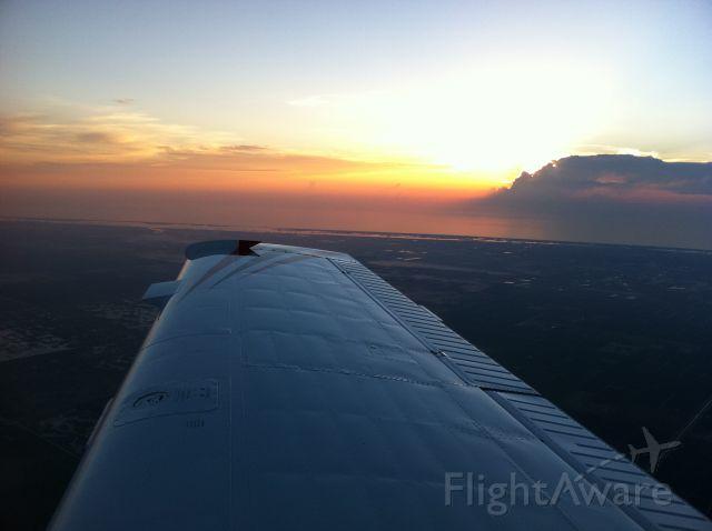 Beechcraft Bonanza (36) (N23HE) - Sunrise off the wing in Stuart