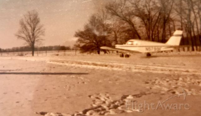 Piper Cherokee (N5799F) - Not the best photo...taken with an old Kodak 110 at IL52, Carthage, IL in February of 1978. N5799F was owned by Stan Little of LaHarpe, IL.