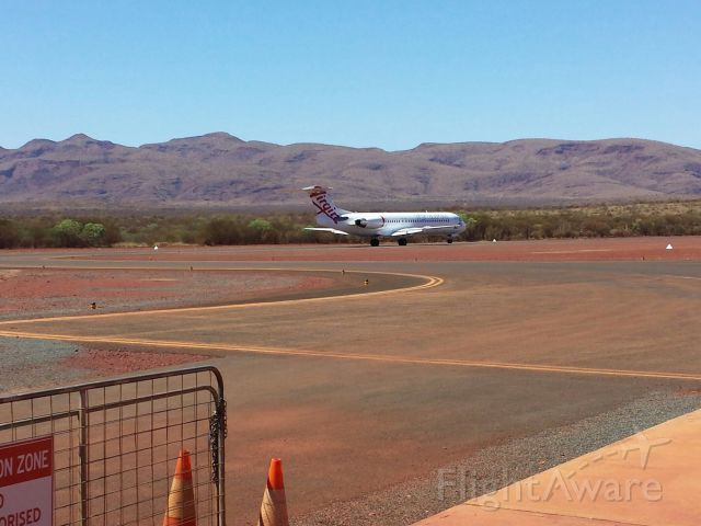 Fokker 100 (VH-FSQ) - FSQ seconds from lift off out of West Angelas airport against a nice backdrop provided by the Hamersley Ranges in Western Australias Pilbara.