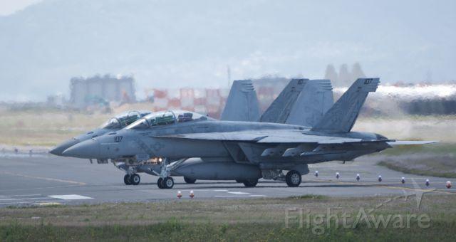 McDonnell Douglas FA-18 Hornet — - VFA-102 (Diamondbacks) holding short on bravo before taking of to Iwao Jima.