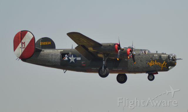 Consolidated B-24 Liberator (N224J) - Consolidated B-24J on final to Runway 21 in Sioux Falls SD on 7-12-2013