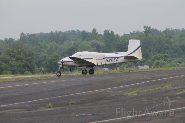 Beechcraft Twin Bonanza (N28EC) - Copyright 2013 GA Spotter Photography