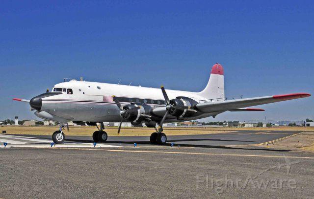 Douglas C-54 Skymaster (N460WA) - Douglas C-54 Skymaster with Sam and Ryan taking runway three-zero for departure at Merced Regional Airport (KMCE)