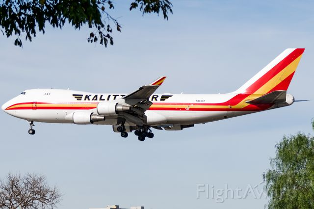 Boeing 747-400 (N403KZ) - Centered in the middle of the trees on arrival from Indianapolis
