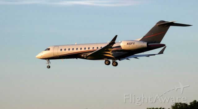 Bombardier Global Express (N92FX) - On final at twilight is this 2004 Bombardier Global Express 6000 in the Spring of 2019.