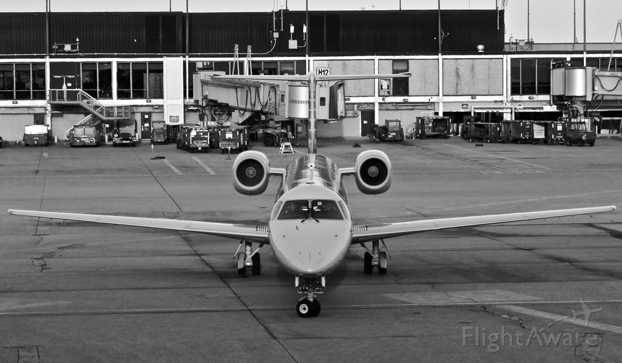 N661JA — - An American Eagle ERJ-145 taxies into the G concourse at Chicago's O'hare International Airport