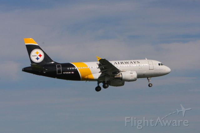 """Airbus A319 (N733UW) - This photo of U.S. Airways N733UW is """"Steelers"""" livery was taken at Reagan National Airport in Washington DC. on NOvember 10, 2011.  The picture was taken from Gravelly Park at the North end of the runway."""