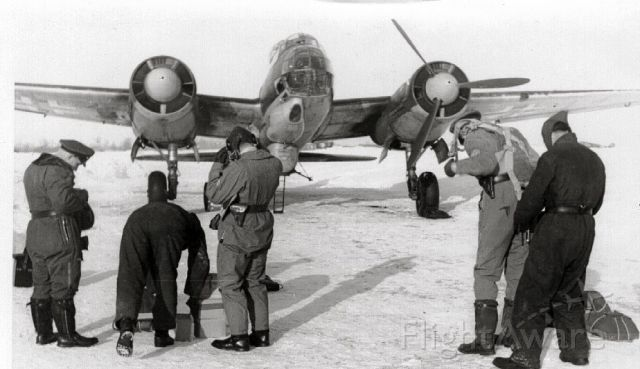Grumman Goose (C-GYVG) - Ju 88 Russian Front 1942 - My dad getting his chute fitted before  Long Distance Reconnaissance Mission.  On a subsequent flight he was shot down deep inside Russia and kept as a prisoner of war for 7 years until 1949.