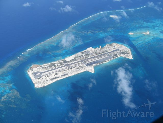 — — - Johnston Island Airfield, photographed from Cessna 208 N696PW on ferry flight from California, Hawaii, Majuro, Saipan, and Korea.  Shot taken from 8000 feet, with photo window open.  January 2009