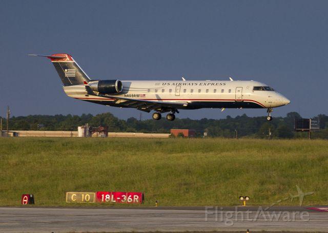 Canadair Regional Jet CRJ-200 (N403AW) - Landing on runway 18L as the sun goes down at Charlotte, North Carolina USA.