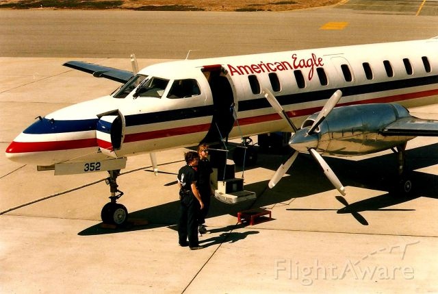 Fairchild Dornier SA-227DC Metro (N352AE) - Monterey, CA  June 1988 shows an American Eagle awaiting passengers as the ground crew is all set to assist boarding. This photo taken before the Obs deck was glassed off and forever ruining a great Obs deck for photos.