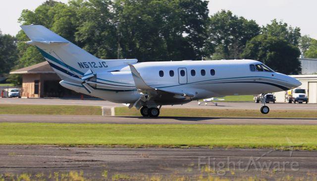 Raytheon Hawker 800 (N512JC) - A Hawker 800XP deploying thrust reversers after arriving Runway 23, Thomas J. Brumlik Field, Albertville Regional Airport, AL - June 15, 2017. Auto color corrected due to haze and intense sunlight. Best seen full-size.
