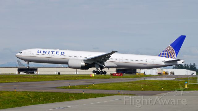 BOEING 777-300 (N2140U) - BOE760 landing on Rwy 34L to complete a second C1 flight on 5.9.17. (ln 1489 / cn 62651).