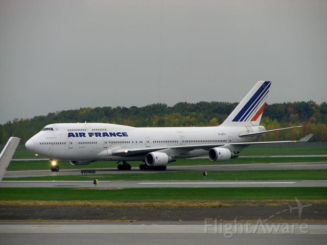 Boeing 747-200 (F-GITC) - Air France F-GITC taxiing at Montréal Trudeau Airport, taken from the departure lounge on Sept. 27, 2009