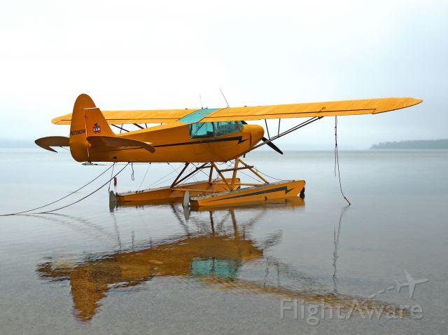 N736DW — - low ceilings, fog, and calm water