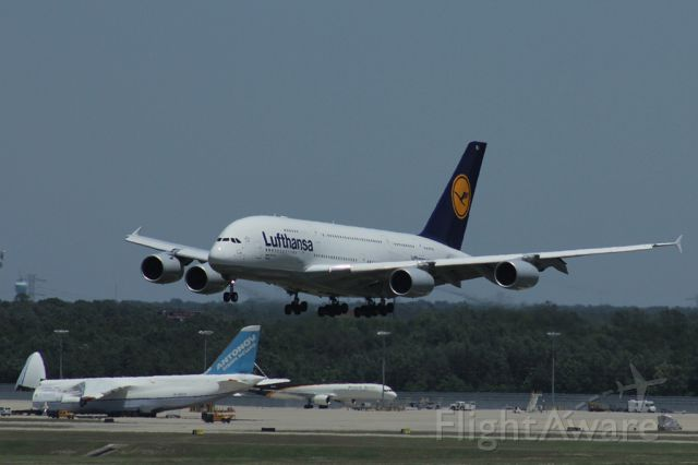 Airbus A380-800 (D-AIMJ) - Landing at KIAH with an Antonov A124 in the background
