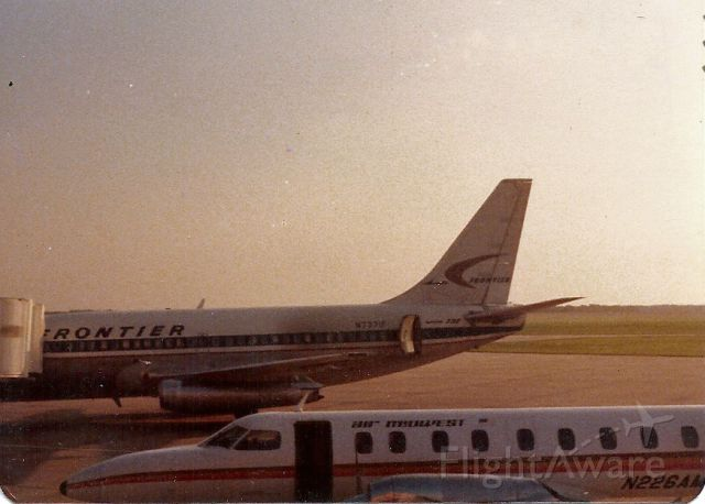 Boeing 737-100 (N737F) - This photo went through the Joplin EF-5 tornado last year. Sorry for the damage to it. Enjoy it for what it is. 1978? Frontier Sitting at the ramp and a Metro. KJLN Joplin Regional Airport.
