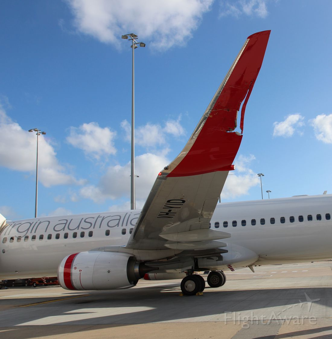 Boeing 737-700 (VH-YID) - Damage to the winglet of VH-YID after a ground collision in Melbourne with Jetstar A320.
