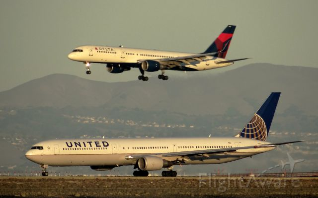 BOEING 767-400 (N66057) - On takeoff roll with a DAL - B752 on Final (N721TW).