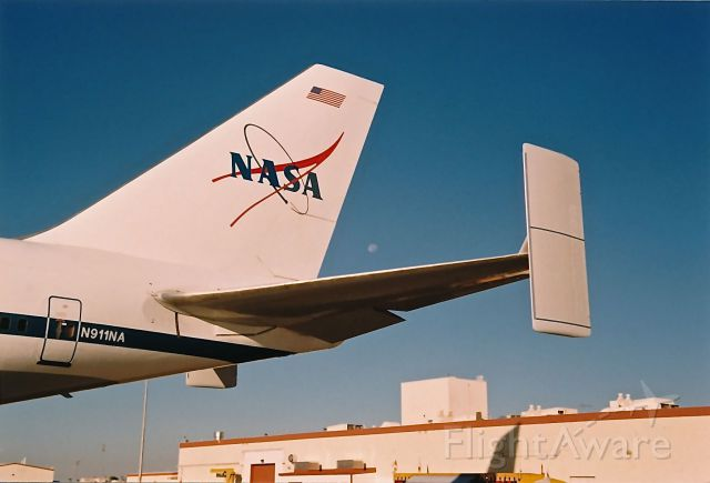 Boeing Shuttle Carrier (N911NA) - The tail of NASA Shuttle B-747 framing the moon. The aircraft was on display at the Edwards AFB Open House and Air Show 10-18-1997