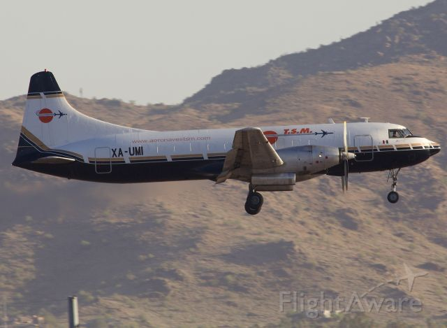 """CONVAIR CV-580 (XA-UMI) - This Convair 340 was originally delivered to Braniff Airways in 1953. Amazing to see it still in regularly scheduled service with Aeronaves TSM. This bird was retrofitted with Rolls Royce Dart Turboprops and is now classified as a CV-640. Thanks to George Maidens for pointing this out in the comments!! A true treat to see as I had never photographed an active airborne former Braniff aircraft! (Please view in """"Full"""" for best image quality)"""