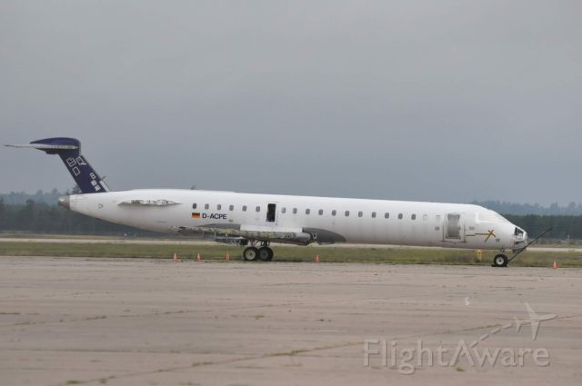 Canadair Regional Jet CRJ-700 (D-ACPE) - Lufthansa Cityline sitting on the apron at Sawyer International Airport.