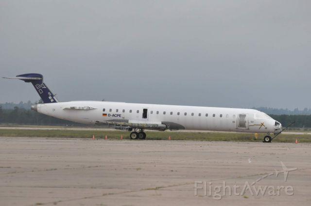 Canadair Regional Jet CRJ-700 (D-ACPE) - Lufthansa Cityline sitting on the apron at Sawyer International Airport.