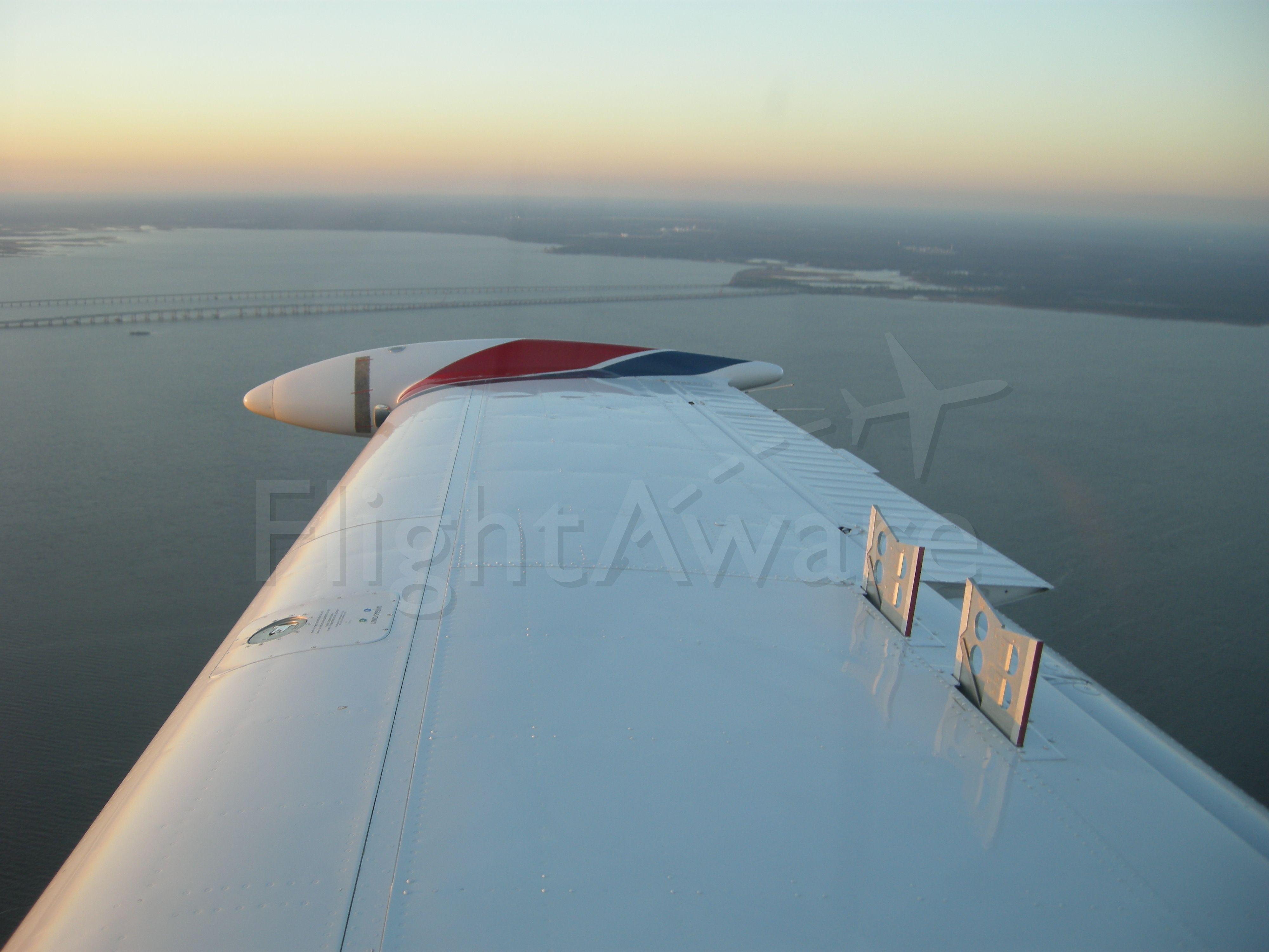 Beechcraft Bonanza (33) (N72JK) - Using the spoilers!