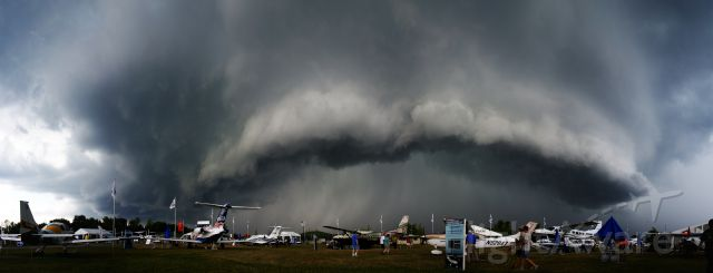— — - A storm rolls in at the 2012 EAA Airventure