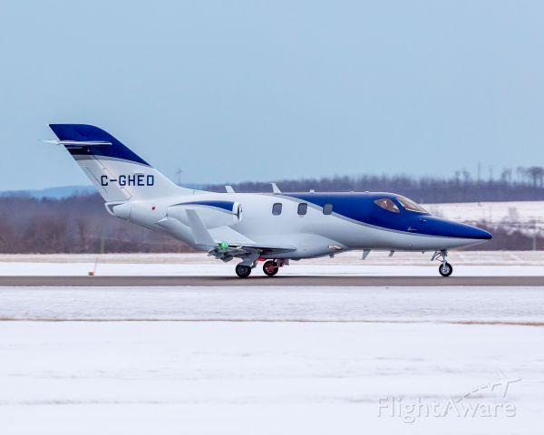 Honda HondaJet (C-GHED) - The first HondaJet registered in Canada landing on runway 30.