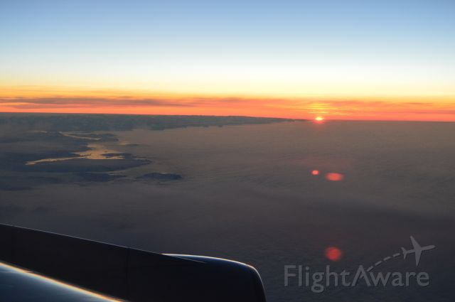 Boeing 747-400 — - Sunrise over East Coast of Greenland. Taken on United 58, SFO-FRA, July 2, 2016
