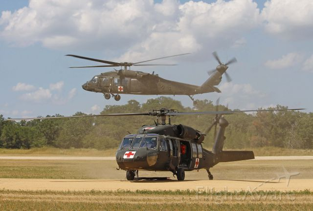Sikorsky S-70 (9026307) - US Army National Guard UH-60A Blackhawk 90-26307 kicking up the grass & dust on approach behind 82-23698 at Fort McCoy/Young Air Assault Strip (WS20) on 17 Jul 2013.