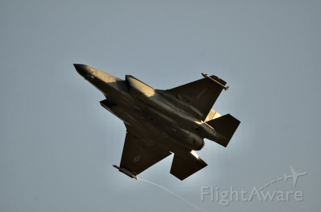 """— — - VMFA-121 """"Green Knights"""" F-35B rotates out of RJOI with a visible contrail coming of right wingtip."""