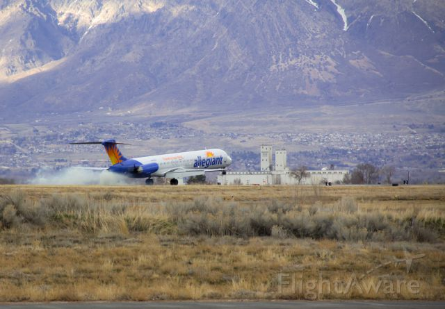 McDonnell Douglas MD-80 (N868GA) - Smokin the mains landing in OGD.