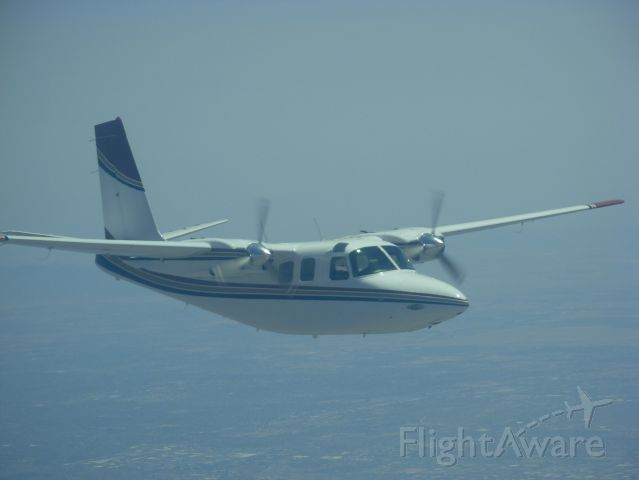 Aero Commander 500 (N3UV) - Picture taken over PHX by M.Hardy.