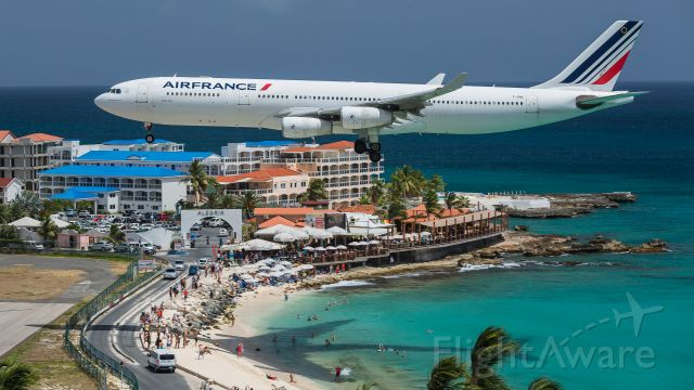 Airbus A340-300 (F-GNII) - Air France Airbus A343 over the maho beach for landing a sight never to be seen again!!<br />This airframe is now being operated by plus ultra as EC-MQM.