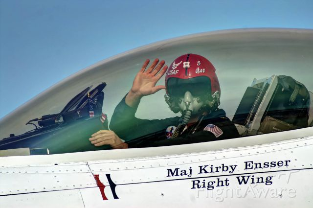 Lockheed F-16 Fighting Falcon — - Maj. Kirby Ensser, right wing for for U.S. Thunderbirds, gives a wave after a demonstration at Tyndall AFB.