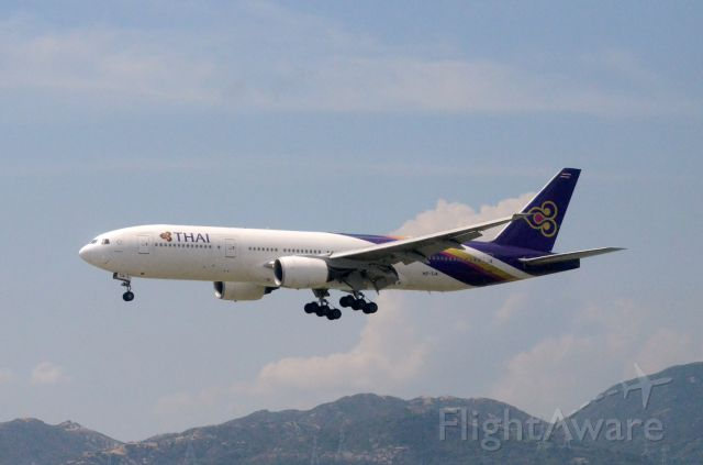 Boeing 777-200 (HS-TJA) - Airline: Thai Airways International (TG/THA); Airport: Hong Kong International Airport (HKG/VHHH); Camera: Nikon D7000; Date: 4 July 2011