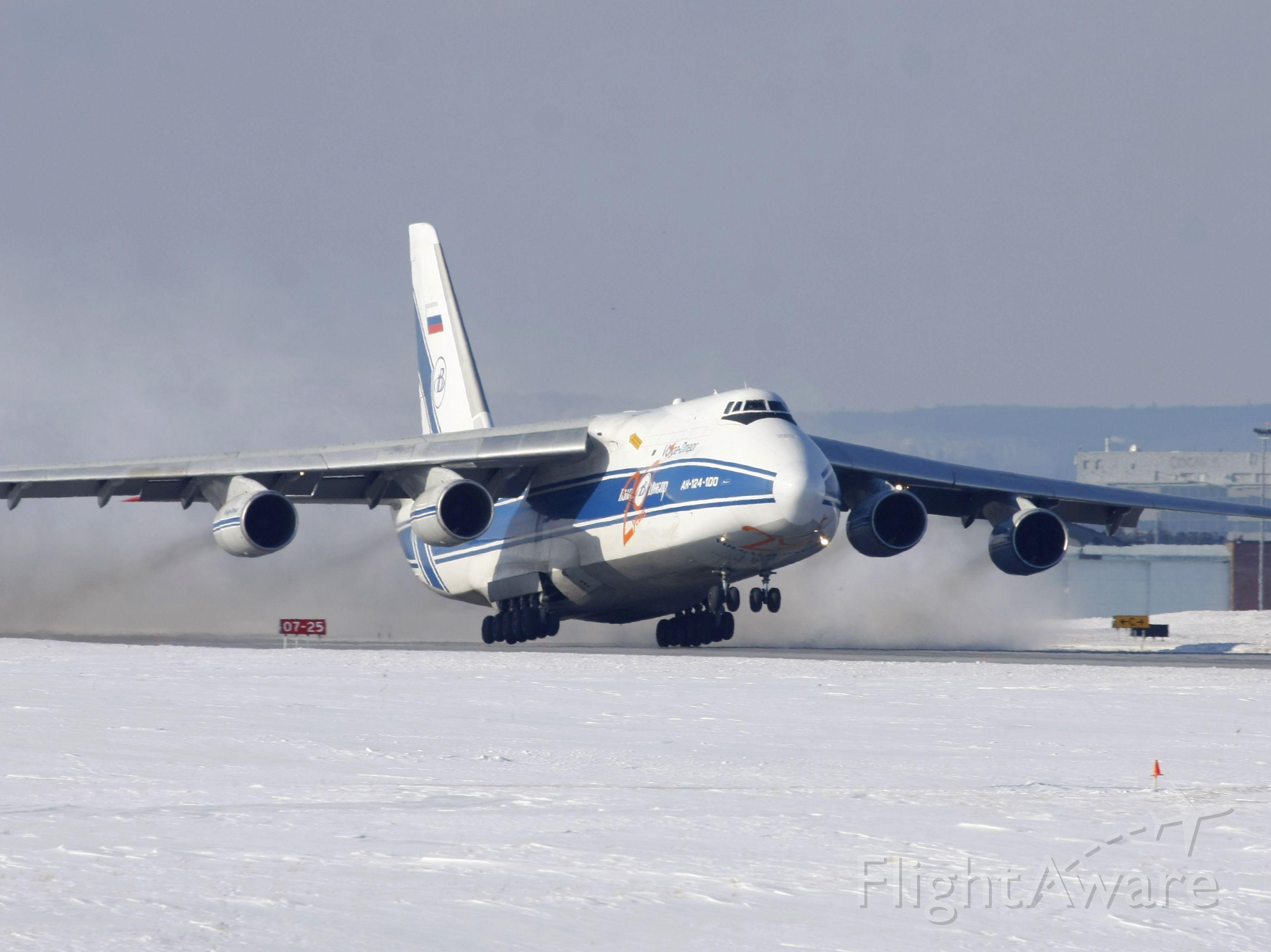 Antonov An-124 Ruslan (RNA82045) - The Russian Blizzard Maker lifting off Runway 14 on Feb 11, 2011 as flight VDA2118 to KNUQ
