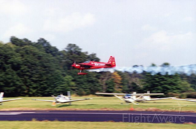 STEPHENS Akro (N10LL) - SUSSEX AIRPORT-SUSSEX, NEW JERSEY, USA-AUGUST 1994: Pictured at the 1994 Sussex Airshow, flying his Akro Laser 200, is former U.S. National and World Aerobatic Champion Leo Loudenslager. Always a favorite with the crowd, Leo would return each year, schedule permitting, to perform at Sussex.