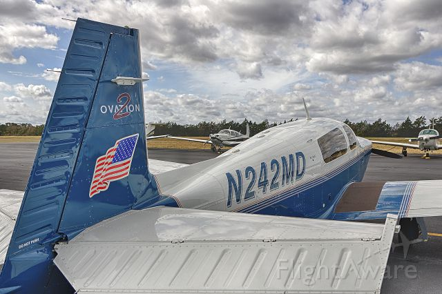 Mooney M-20 (N242MD) - Taken by Win W. while parked.