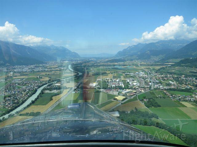 Pilatus PC-6B Turbo-Porter (HB-FLI) - Lining up with the turf runway 33 of Bex aerodrome in the valley of the Rhone, Switzerland.
