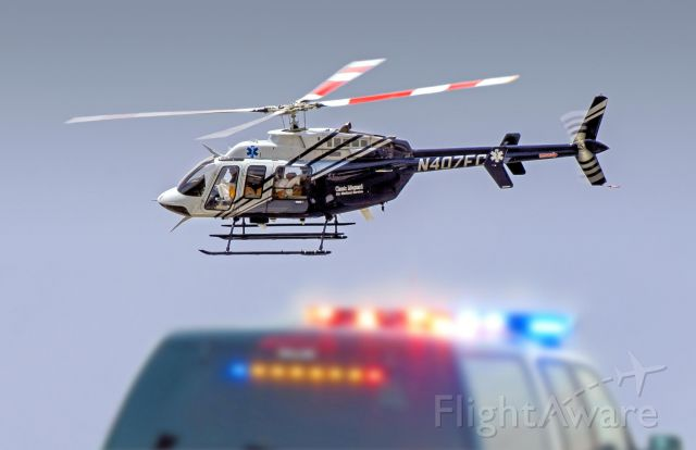 Bell 407 (N407FC) - Photographed this Bell 407 leaving an accident area with patient.