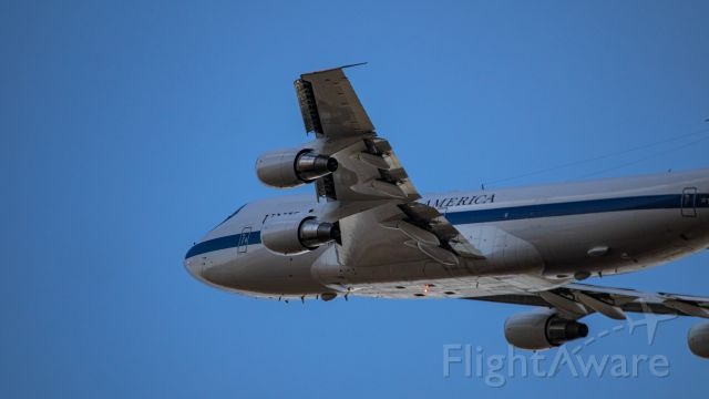 75-0125 — - One of Offutt Air Force Base's Boeing E-4Bs doing a left close traffic over my driveway off of runway 30 in a gorgeous sunset setting. Lucky beacon completes the shot.