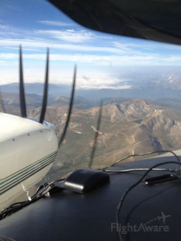 Beechcraft Duke (N500RS) - Over the Colorado Rocky Mountains,  Obscured down in the valley!