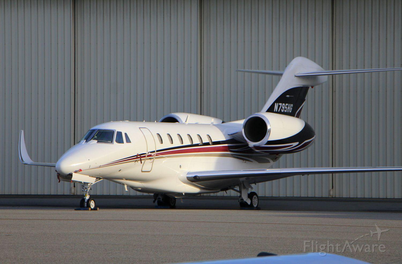 Cessna Citation X (N795HG) - KMRY - Monterey Jet Center ramp N795HG sporting a new paint job - - ATT Pro Am Gold week 2015