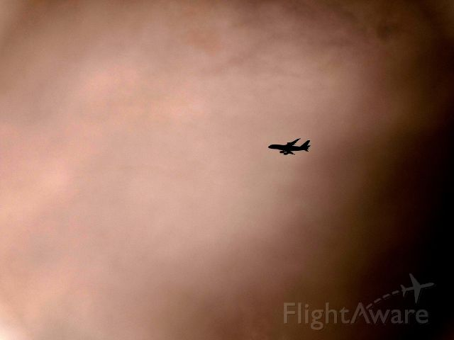 Airbus A380-800 (A6-EDD) - Clearing the dark clouds: Emirates 434 to Brisbane passing bad weather.